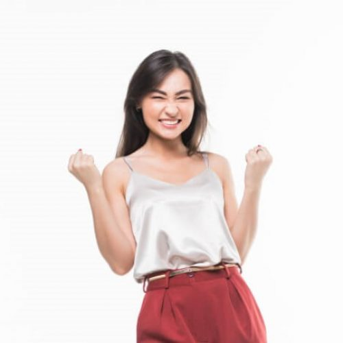 young-asian-woman-with-winning-gestere-isolated-white-wall_231208-1136-1.jpg